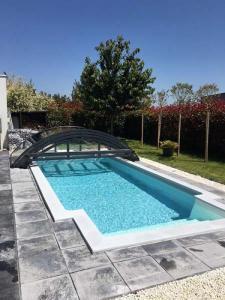 abri de piscine bas cintré belgique