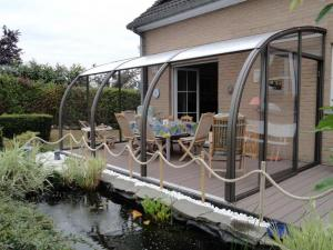 abri terrasse cintré belgique